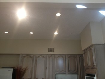 Cabinet painting & Re-set light installation in Katy, TX